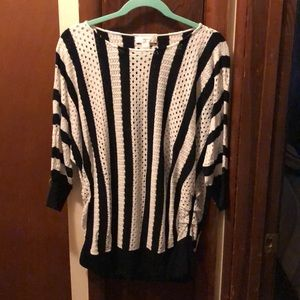 Black and white striped sweater with open area